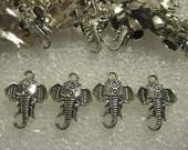Ganesha Head Elephant Charms Lot --- 35 + Tibetan Silver Earring or Necklace Charms
