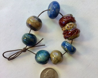 7 Rich colored Artisan porcelain beads, hand made