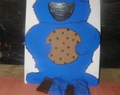 New   cookie   monster  bean  toss  into hole  in   mouth
