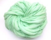 Super bulky handspun yarn, 53 yards and 3.5 ounces/ 100 grams, spun thick and thin in mint green merino wool