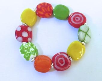 Beaded Bracelet, Kazuri Bangle, Fair Trade, Ceramic Jewellery, Red Orange Green and Yellow Bangle
