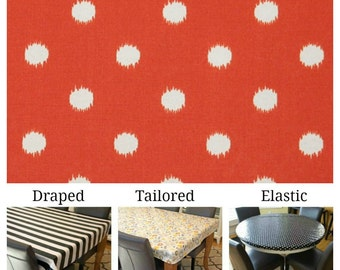 Indoor/Outdoor tablecloth custom size and fit choose elastic, tailored, or draped, White Ikat dots on Orange