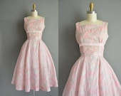 vintage 1950s dress. 50s pink and sliver shimmery fan print full skirt dress.