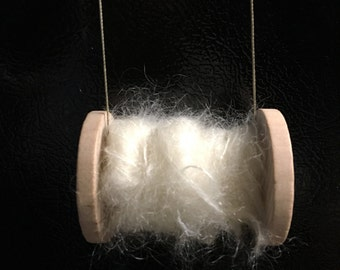 Tree ornament spinning bobbin with yarn