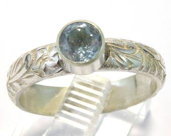 Sky Blue Topaz Faceted Bezel Set Gemstone on Floral Pattern Sterling Silver Band