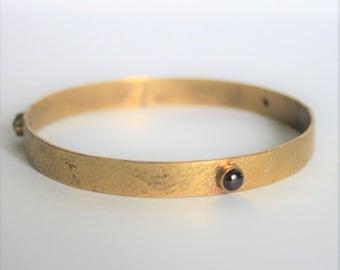 Vintage gold plated bangle. Red stone bangle. Etruscan style bangle