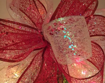 Lg Christmas Tree topper bow made of a red lace glitter and a white lace iridescent glitter ribbons