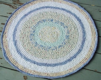 28 by 30 inch oval crocheted rag rug