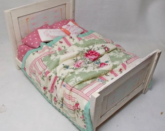 Dolls House Antique Cream Wooden Unmade Bed with Pink / Green quilt.