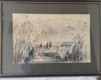 A framed, vintage watercolour painting of Oast houses.