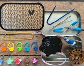 Color your own! The Knitter's Tool Tin with notions for your knitting bag - adult coloring book