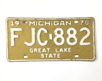 vintage Michigan license plate 1970 yellow and white great lake state
