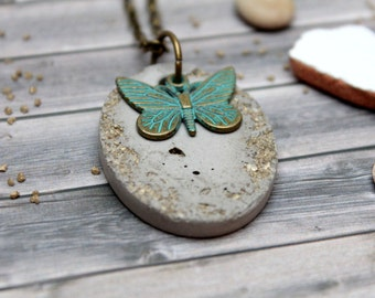 Concrete necklace with golden stones and butterfly