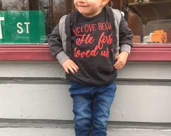 We Love Because He First Loved Us Black Tri Blend Tee
