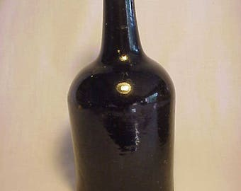 c1750-1790 Black Glass Mallet Style Utility Bottle Dark Olive Green with an applied lip and Large Open Pontil Base