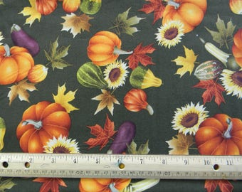 Autumn Leaves Pumpkins and Sunflowers on green cotton quilting fabric by Rosemarie Lavin for Windham Fabrics