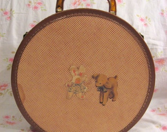 Vintage girls round retro suit case or doll case, comes with old musty doll clothes