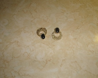 vintage clip on earrings goldtone filigree black glass
