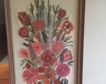 Framed floral crewel work