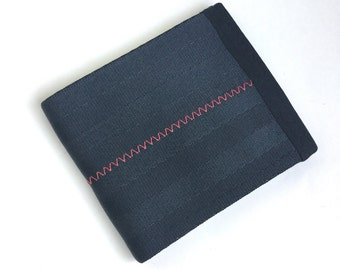 Vegan wallet in black seat belt webbing with red stitching