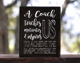 A COACH TEACHES motivates us, inspires us to achieve the impossible...sign block