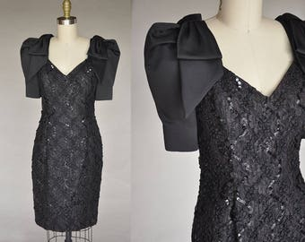 Vintage 80s Black Slim Fit Sequin and Ribbon Black Dress with Avant Garde Bow Shoulders