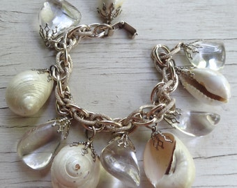 Vintage dangly bracelet with white sea shell and clear crystal charms