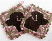 Labrador Retriever Potholders. Pink camouflage, crochet pot holders with chocolate Labs.