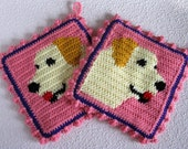 Labrador Retriever Pot Holders.  Pink, crochet potholders with yellow Labs.