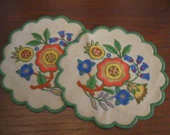 Two round embroidered doilies, in an eastern European motif