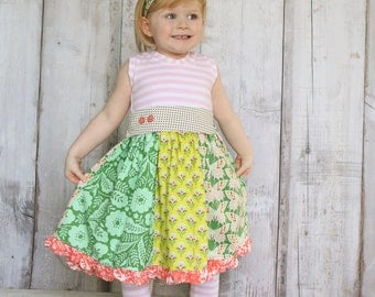 Girls tank style dress with split skirt and sash.  .    Available girls 12 months to 12 years.
