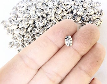 100pc ladybug beads in an antiqued silver color little tiny very small ladybugs bulk destash wholesale