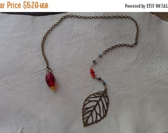 Etsy On Sale Price Drop,Was10.20,Now5.20, Pendulum, Red Glass with Yellow Point,Red and Blue ABfaceted beads,Brass Chain,Finished w a Large