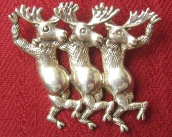 SALE CAROL FELLEY Sterling Silver Brooch of 3 Dancing Moose Marked with her Logo.  Dated 90. (1990).