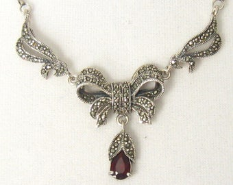 Sterling Art Nouveau Necklace has Marcasites in all 4 of its Centerpiece Parts (Bow, 2 Swirls, and Drop) Plus a Teardrop Garnet in the Drop