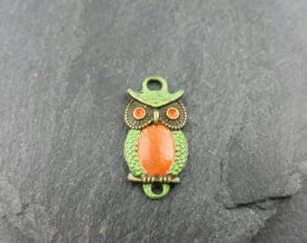 Antique bronze owl hand painted with orange and green patina.