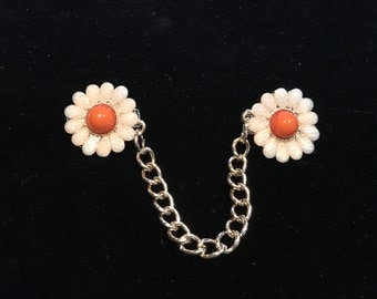 Sweater Clips: Flowers with Iridescent White Pedals and Orange Center