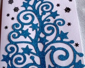 Glitttery blue Christmas tree with a modern twist black snowflakes