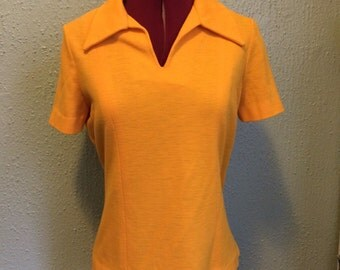 1970s yellow knit blouse with dagger collar
