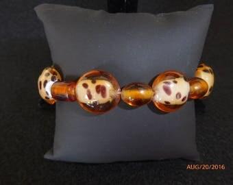 "Leopard and brown stretch bracelet arropx 7"" round"