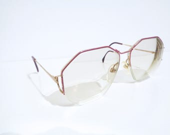 Vintage Silhouette Over size eye glasses in Lilac and Gold. Thin, minimalistic half rim frame.