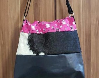 KUHIE®, cow fur bag made of black leather, black and white cowhide and pink denim