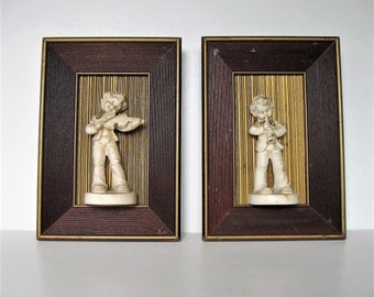 "Pair of Mid Century framed figurines, 3-D boy playing instrument, Nursery decor, 6 3/4"" x 9 3/4"", wooden shadow box wall hangings, gift idea"