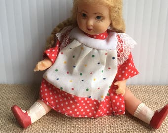 Vintage celluloid little doll with red poka dot dress Italy