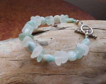 Genuine sea glass bracelet.  With aquamarine beads.  Real beach glass.  Will resize to fit. Ocean vibe.