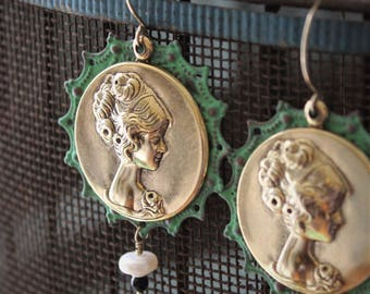 Cameo Earrings: Golden brass cameos layered with patina filigree with small pearl and black onyx dangle on 14k gold filled ear wire