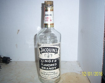 1970's Jacquin's Ginger Brandy Phila Pa Auburndale Fla Whiskey Bottle 11 3/4 inches tall with label
