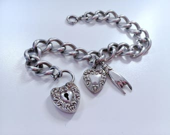 Antique Victorian repousse heart padlock bracelet with puffy heart and Mano Cornuto charms Sterling Silver