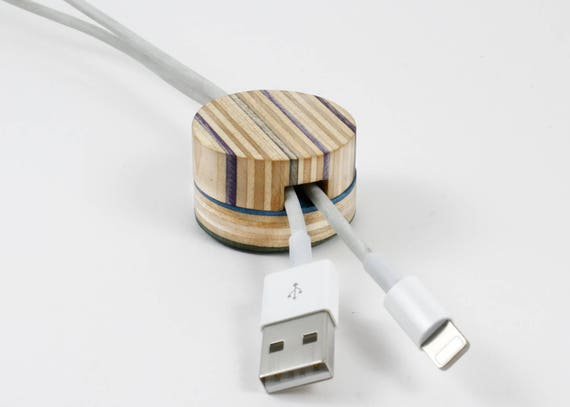 The No. 1 Cable Stop is hand-made using broken skateboards. Keeps cables where you left them.