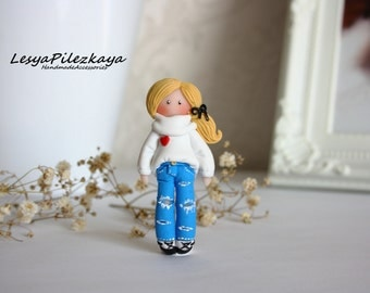 Polymer Clay Girl in a jeans and white pullover with heart